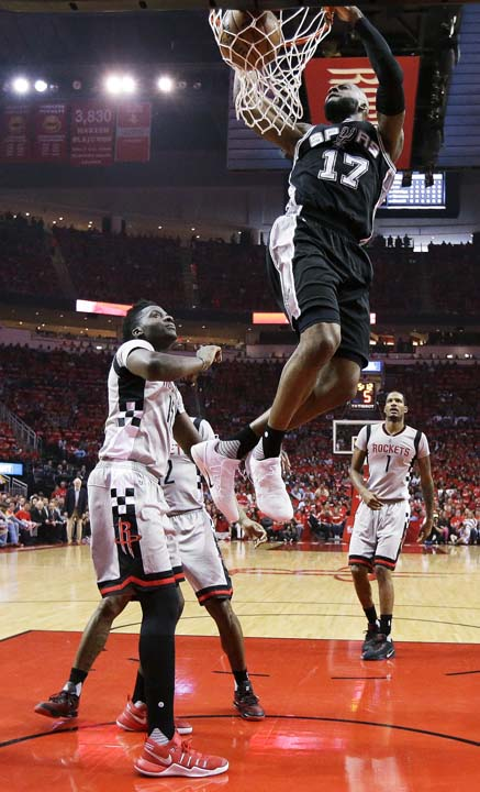 <div class='meta'><div class='origin-logo' data-origin='KTRK'></div><span class='caption-text' data-credit='AP'>San Antonio Spurs guard Jonathon Simmons (17) dunks over Houston Rockets center Clint Capela. front left, during the first half in Game 6. (AP Photo/Eric Christian Smith)</span></div>