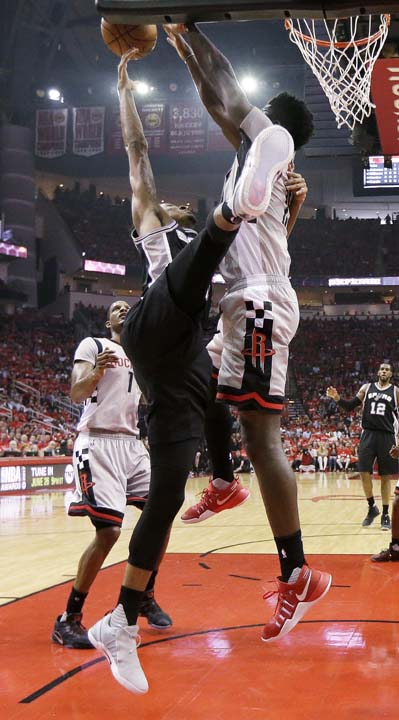 <div class='meta'><div class='origin-logo' data-origin='KTRK'></div><span class='caption-text' data-credit='AP'>Houston Rockets center Clint Capela, right, blocks the shot of San Antonio Spurs guard Dejounte Murray during the first half in Game 6. (AP Photo/Eric Christian Smith)</span></div>