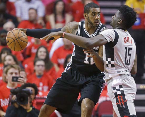 <div class='meta'><div class='origin-logo' data-origin='KTRK'></div><span class='caption-text' data-credit='AP'>San Antonio Spurs forward LaMarcus Aldridge, left, dribbles as Houston Rockets center Clint Capela defends during the first half in Game 6. (AP Photo/Eric Christian Smith)</span></div>