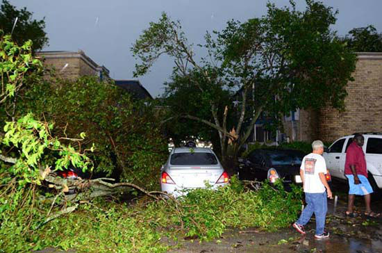 <div class='meta'><div class='origin-logo' data-origin='none'></div><span class='caption-text' data-credit='Photo/SCHNUR,J.A.'>The scene at an apartment complex that partially collapsed this morning as a result of a possible tornado in southwest Houston</span></div>