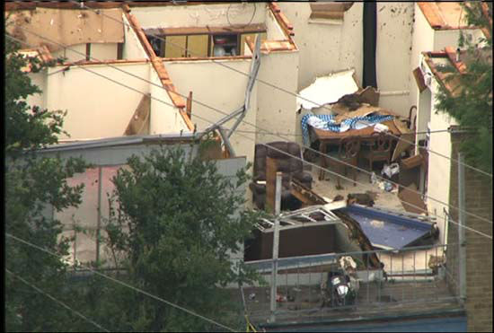 <div class='meta'><div class='origin-logo' data-origin='none'></div><span class='caption-text' data-credit='KTRK Photo/ KTRK'>A view of the damage over apartment buildings in southwest Houston after severe storms</span></div>