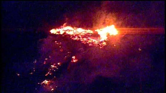 <div class='meta'><div class='origin-logo' data-origin='KTRK'></div><span class='caption-text' data-credit='KTRK'>Aerial images of a lumber yard fire near Pearland</span></div>