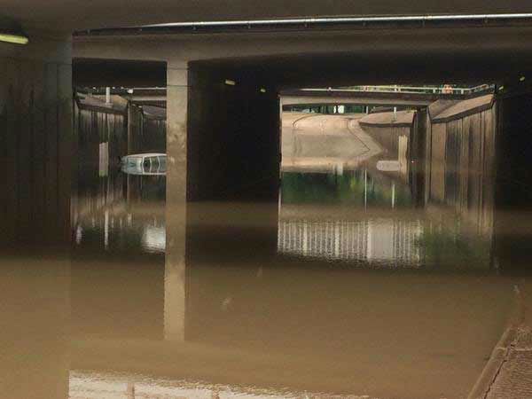 <div class='meta'><div class='origin-logo' data-origin='none'></div><span class='caption-text' data-credit='Pooja Lodhia/Photo'>This photo shows a vehicle submerged in high water on Allen Parkway near downtown Houston.</span></div>