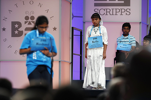 """<div class=""""meta image-caption""""><div class=""""origin-logo origin-image ap""""><span>AP</span></div><span class=""""caption-text"""">Kelly Haven, 12, of Fort Defiance, Ariz., center, who is sponsored by the Navajo Times, waits to compete in the 90th Scripps National Spelling Bee in Oxon Hill, Md. (AP Photo/Jacquelyn Martin)</span></div>"""