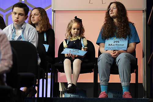"""<div class=""""meta image-caption""""><div class=""""origin-logo origin-image ap""""><span>AP</span></div><span class=""""caption-text"""">Edith Fuller, 6, of Tulsa, Okla., center, the youngest speller ever in the National Bee, sits next to Marlene Schaff, 14, of Lake Forest, Ill., right. (AP Photo/Jacquelyn Martin)</span></div>"""