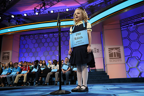 """<div class=""""meta image-caption""""><div class=""""origin-logo origin-image ap""""><span>AP</span></div><span class=""""caption-text"""">Edith Fuller, 6, of Tulsa, Okla., the the youngest speller in history in the National Bee, smiles as she spells her word correctly. (AP Photo/Jacquelyn Martin)</span></div>"""