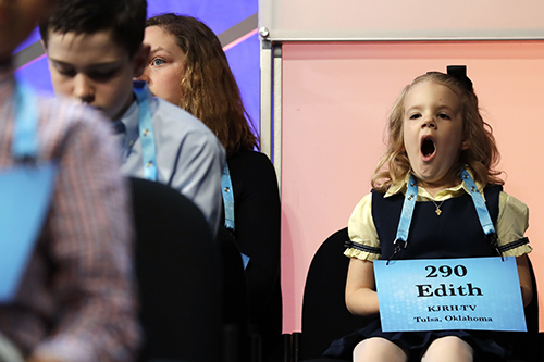 """<div class=""""meta image-caption""""><div class=""""origin-logo origin-image ap""""><span>AP</span></div><span class=""""caption-text"""">Edith Fuller, 6, of Tulsa, Okla., the youngest speller in history to compete in the bee, yawns as she waits to compete in the 90th Scripps National Spelling Bee. (AP Photo/Jacquelyn Martin)</span></div>"""
