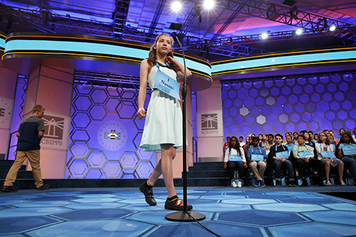 """<div class=""""meta image-caption""""><div class=""""origin-logo origin-image ap""""><span>AP</span></div><span class=""""caption-text"""">Naomi Zarin, 12, of Gray, Maine, approaches the microphone as the first speller in the opening round of the 90th Scripps National Spelling Bee in Oxon Hill, Md. (AP Photo/Jacquelyn Martin)</span></div>"""
