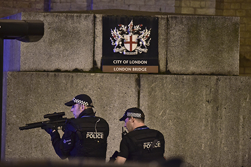 <div class='meta'><div class='origin-logo' data-origin='AP'></div><span class='caption-text' data-credit='Dominic Lipinski/PA via AP'>An armed Police officer looks through his weapon on London Bridge in London, Saturday, June 3, 2017.</span></div>