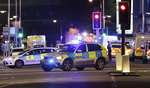 <div class='meta'><div class='origin-logo' data-origin='AP'></div><span class='caption-text' data-credit='AP Photo/ Matt Dunham'>Police cars in the area of London Bridge after an incident in central London, late Saturday, June 3, 2017.</span></div>