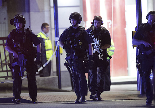 <div class='meta'><div class='origin-logo' data-origin='AP'></div><span class='caption-text' data-credit='Yui Mok/PA via AP'>Armed police outside Monument station after an incident in central London, Saturday, June 3, 2017.  British police said they were dealing with &#34;incidents.&#34;</span></div>