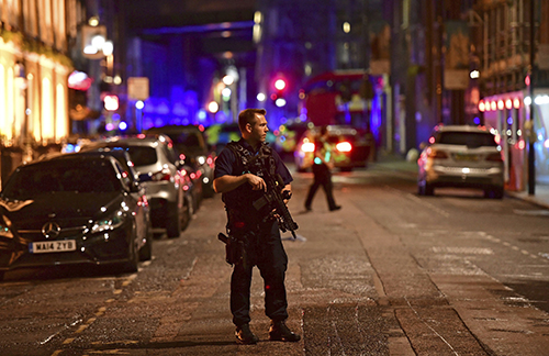 <div class='meta'><div class='origin-logo' data-origin='AP'></div><span class='caption-text' data-credit='Dominic Lipinski/PA via AP'>An armed policeman stands on Borough High Street as police are dealing with an incident on London Bridge in London, Saturday, June 3, 2017.</span></div>