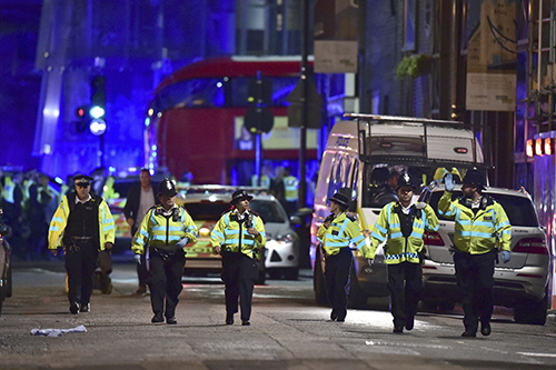<div class='meta'><div class='origin-logo' data-origin='AP'></div><span class='caption-text' data-credit='Dominic Lipinski/PA via AP'>Police officers on Borough High Street as police are dealing with an incident on London Bridge in London, Saturday, June 3, 2017.</span></div>