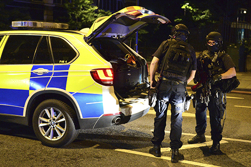 <div class='meta'><div class='origin-logo' data-origin='AP'></div><span class='caption-text' data-credit='Dominic Lipinski/PA via AP'>Armed police stand on Borough High Street after an incident in central London, Saturday, June 3, 2017. Terrorism struck at the heart of London, police said Sunday.</span></div>