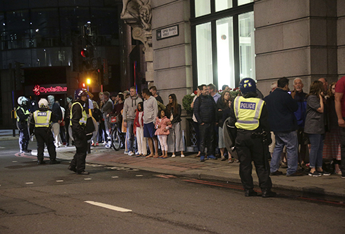 <div class='meta'><div class='origin-logo' data-origin='AP'></div><span class='caption-text' data-credit='Yui Mok/PA via AP'>Guests from the Premier Inn Bankside Hotel are evacuated and kept in a group with police on Upper Thames Street following an incident in central London, Saturday, June 3, 2017.</span></div>