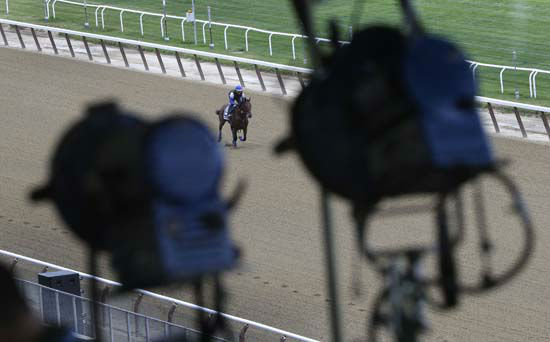 "<div class=""meta image-caption""><div class=""origin-logo origin-image none""><span>none</span></div><span class=""caption-text"">Television broadcast lights hang from the rafters of the grandstand at Belmont Park as American Pharoah gallops around the track (AP Photo/ Julie Jacobson)</span></div>"