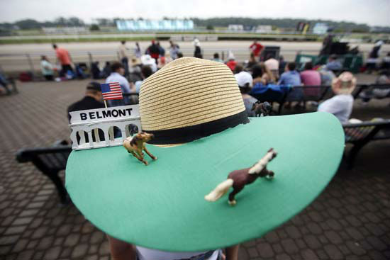 "<div class=""meta image-caption""><div class=""origin-logo origin-image none""><span>none</span></div><span class=""caption-text"">Donna Zirbes-Steinmetz, of Lindenhurst, N.Y., wears a race-themed hat before the 147th running of the Belmont Stakes horse race at Belmont Park (AP Photo/ Jason DeCrow)</span></div>"