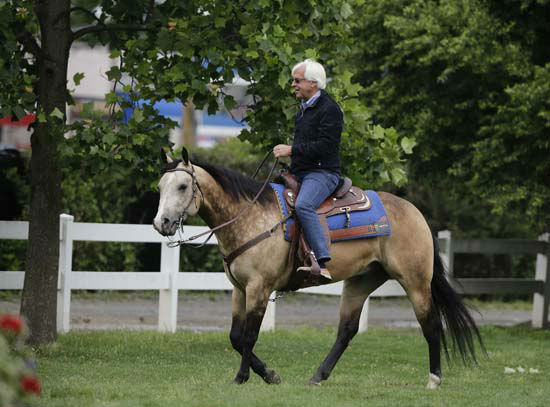 "<div class=""meta image-caption""><div class=""origin-logo origin-image none""><span>none</span></div><span class=""caption-text"">Bob Baffert, trainer for Kentucky Derby and Preakness Stakes winner American Pharoah, rides his pony Smokey around the grass (AP Photo/ Julie Jacobson)</span></div>"