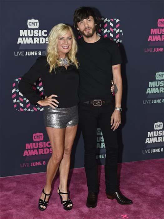 "<div class=""meta image-caption""><div class=""origin-logo origin-image none""><span>none</span></div><span class=""caption-text"">Kelly Lynn Janson, left, and Chris Janson arrive at the CMT Music Awards at the Bridgestone Arena on Wednesday, June 8, 2016, in Nashville, Tenn. (Sanford Myers/Invision/AP)</span></div>"