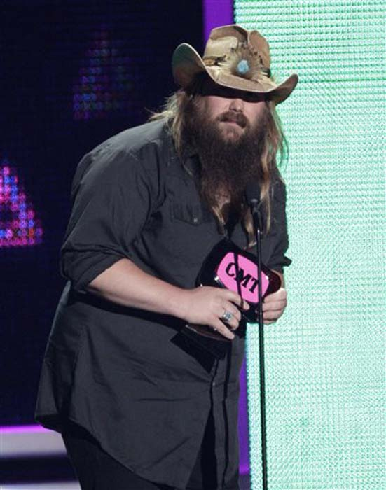 """<div class=""""meta image-caption""""><div class=""""origin-logo origin-image none""""><span>none</span></div><span class=""""caption-text"""">Chris Stapleton accepts the award for breakthrough video of the year for """"Fire Away"""" at the CMT Music Awards at the Bridgestone Arena on June 8, 2016, in Nashville, Tenn. (Wade Payne/Invision/AP)</span></div>"""