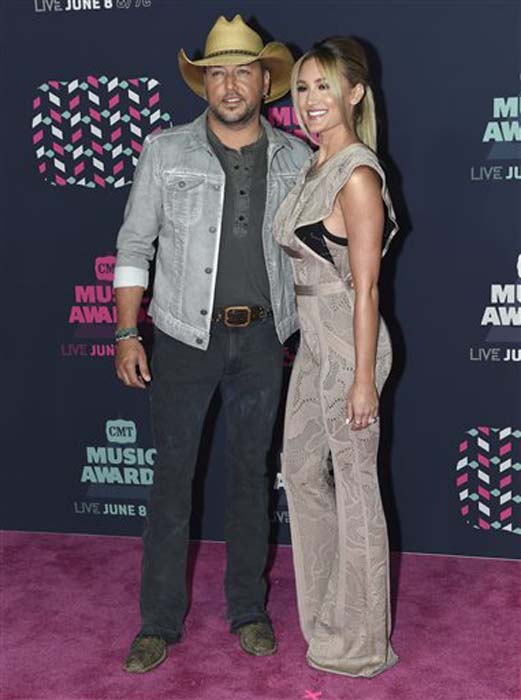 """<div class=""""meta image-caption""""><div class=""""origin-logo origin-image none""""><span>none</span></div><span class=""""caption-text"""">Jason Aldean, left, and Brittany Kerr arrive at the CMT Music Awards at the Bridgestone Arena on Wednesday, June 8, 2016, in Nashville, Tenn. (Sanford Myers/Invision/AP)</span></div>"""