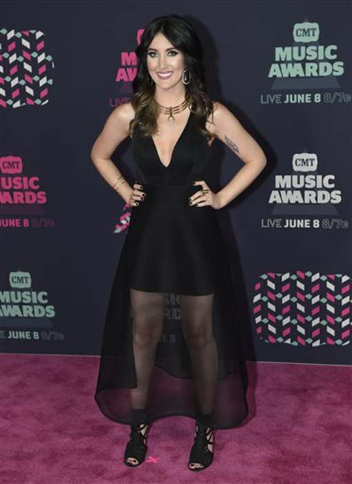 """<div class=""""meta image-caption""""><div class=""""origin-logo origin-image none""""><span>none</span></div><span class=""""caption-text"""">Aubrie Sellers arrives at the CMT Music Awards at the Bridgestone Arena on Wednesday, June 8, 2016, in Nashville, Tenn. (Sanford Myers/Invision/AP)</span></div>"""