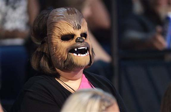 """<div class=""""meta image-caption""""><div class=""""origin-logo origin-image none""""><span>none</span></div><span class=""""caption-text"""">Candace Payne, also known as """"Chewbacca Mom, appears in the audience wearing her Chewbacca mask at the CMT Music Awards at the Bridgestone Arena on June 8 in Nashville, Tenn. (Wade Payne/Invision/AP)</span></div>"""