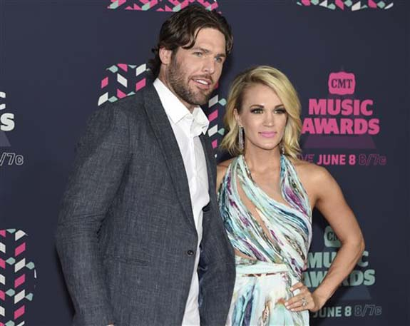 """<div class=""""meta image-caption""""><div class=""""origin-logo origin-image none""""><span>none</span></div><span class=""""caption-text"""">Mike Fisher, left, and Carrie Underwood arrive at the CMT Music Awards at the Bridgestone Arena on Wednesday, June 8, 2016, in Nashville, Tenn. (Sanford Myers/Invision/AP)</span></div>"""