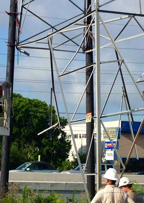 <div class='meta'><div class='origin-logo' data-origin='none'></div><span class='caption-text' data-credit='ABC-13/Steve Campion'>Crews worked to stablize a high voltage power transmission tower that was struck following an apparent road rage incident near the Westpark Tollway.</span></div>