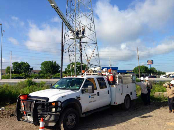Crews worked to stablize a high voltage power transmission tower that was struck following an apparent road rage incident near the Westpark Tollway. <span class=meta>ABC-13/Steve Campion</span>