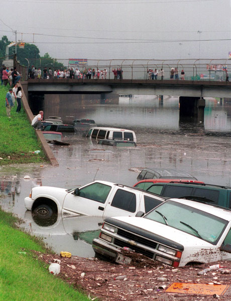 <div class='meta'><div class='origin-logo' data-origin='none'></div><span class='caption-text' data-credit='AP Photo/Donna Carson'>FILE - Trucks, cars and debris float on I-45 North near downtown Houston as onlookers gather on the Main street overpass after torrential rain from Tropical Storm Allison.</span></div>