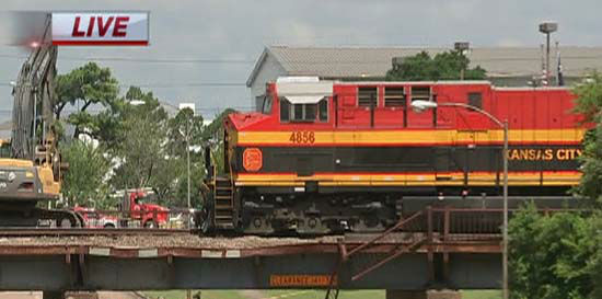 Train derails off bridge over old katy road for Abc motor credit gilchrist rd