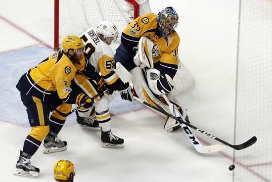 "<div class=""meta image-caption""><div class=""origin-logo origin-image ap""><span>AP</span></div><span class=""caption-text"">Nashville Predators goalie Pekka Rinne (35), of Finland, and Yannick Weber (7), of Switzerland, defend the goal against Pittsburgh Penguins' Jake Guentzel. (AP Photo/Jeff Roberson) (AP)</span></div>"