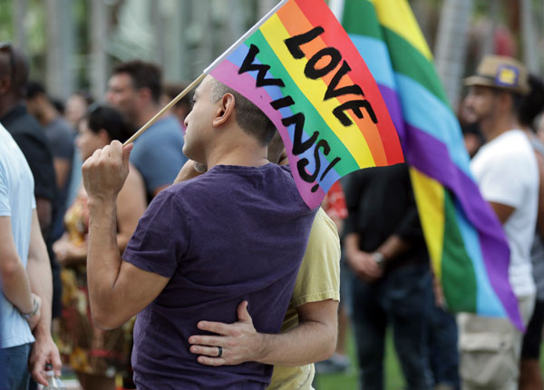 <div class='meta'><div class='origin-logo' data-origin='AP'></div><span class='caption-text' data-credit='AP Photo/Lynne Sladky'>Juan Mantilla, 42, of Miami Beach, Fla., left, stands with his partner during a vigil in memory of the victims of the Orlando mass shooting, Sunday, June 12, 2016, in Miami Beach.</span></div>