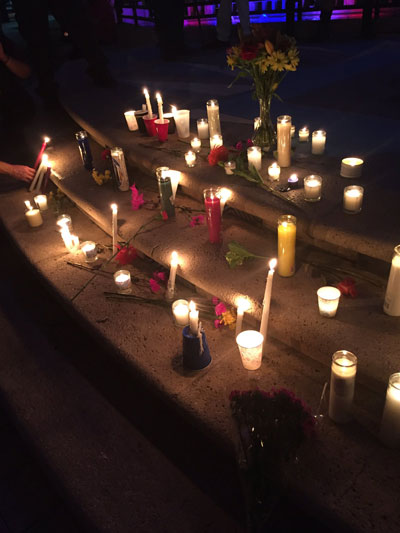 <div class='meta'><div class='origin-logo' data-origin='none'></div><span class='caption-text' data-credit='Megan Bosinger/Twitter'>Mourners leave candles and flowers at a memorial in West Palm Beach, Florida.</span></div>