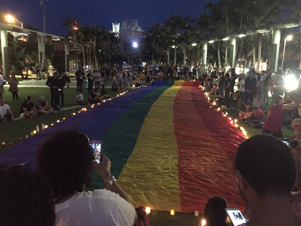 <div class='meta'><div class='origin-logo' data-origin='none'></div><span class='caption-text' data-credit='City of Miami Beach'>Demonstrators gather around a Pride flag in Miami Beach.</span></div>