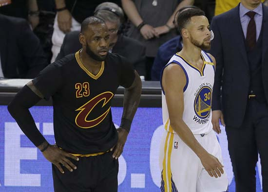 """<div class=""""meta image-caption""""><div class=""""origin-logo origin-image ap""""><span>AP</span></div><span class=""""caption-text"""">Cleveland Cavaliers forward LeBron James (23) and Golden State Warriors guard Stephen Curry (30) during the first half. (AP Photo/Ben Margot) (AP)</span></div>"""