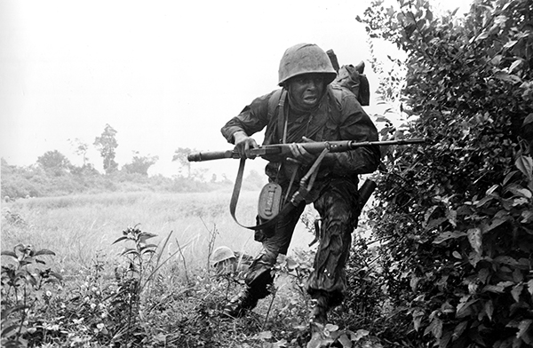 <div class='meta'><div class='origin-logo' data-origin='AP'></div><span class='caption-text' data-credit='AP Photo'>An infantryman of the U.S. 25th Division rushes for cover as he comes under sniper fire near the village of Rach Kien during the Vietnam War.</span></div>