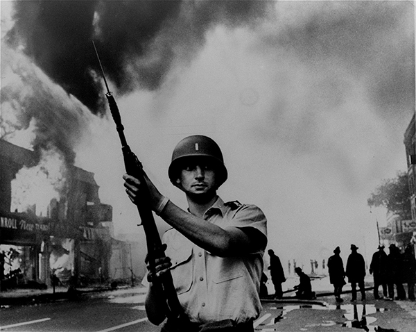 <div class='meta'><div class='origin-logo' data-origin='AP'></div><span class='caption-text' data-credit=''>A National Guardsman stands at the ready at a Detroit intersection during the summer riots of 1967.</span></div>