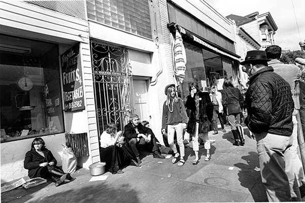 <div class='meta'><div class='origin-logo' data-origin='AP'></div><span class='caption-text' data-credit=''>Young hippies walk along Haight St. in the Haight-Ashbury district of San Francisco, Calif., on April 13, 1967.</span></div>