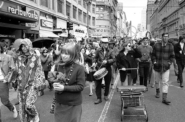 <div class='meta'><div class='origin-logo' data-origin='AP'></div><span class='caption-text' data-credit='AP Photo'>Anti-Vietnam war protesters march on Market Street in San Francisco, Calif. on April 15, 1967.</span></div>