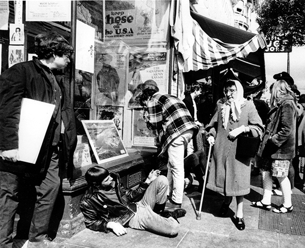 <div class='meta'><div class='origin-logo' data-origin='AP'></div><span class='caption-text' data-credit='AP Photo'>Young hippies straddle the sidewalk as an elderly woman, a long-time resident of the Haight-Ashbury district, walks by in San Francisco, Calif., on April 25, 1967.</span></div>