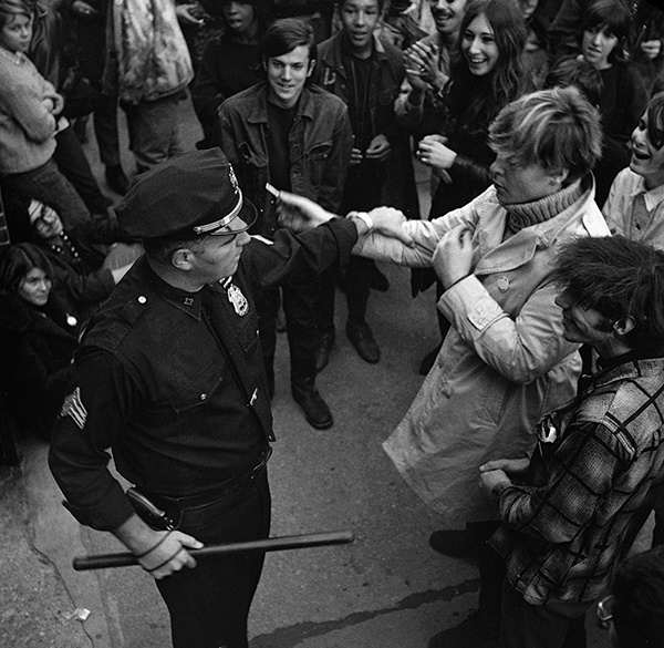 <div class='meta'><div class='origin-logo' data-origin='AP'></div><span class='caption-text' data-credit='AP Photo'>A hippie taunts a New York City policeman with what he called a &#34;joint&#34; on October 7, 1967 during a demonstration at New York's Bellevue Hospital.</span></div>