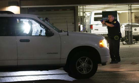 <div class='meta'><div class='origin-logo' data-origin='none'></div><span class='caption-text' data-credit='AP Photo/LM Otero'>Dallas police stop a driver in downtown Dallas, July 7, 2016, following shootings of police officers.</span></div>