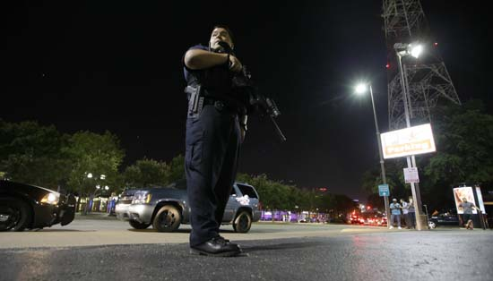 <div class='meta'><div class='origin-logo' data-origin='AP'></div><span class='caption-text' data-credit='AP Photo/LM Otero'>Dallas police stand watch after police officers were shot in downtown</span></div>