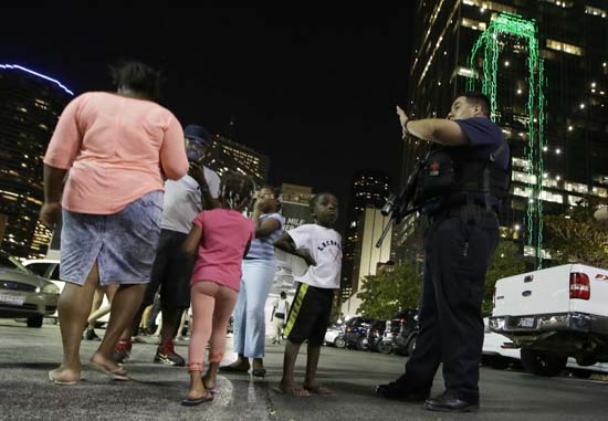 <div class='meta'><div class='origin-logo' data-origin='AP'></div><span class='caption-text' data-credit='AP Photo/LM Otero'>Dallas police order people away from the area after several police were shot in downtown Dallas</span></div>