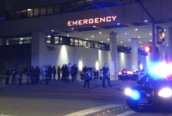 <div class='meta'><div class='origin-logo' data-origin='AP'></div><span class='caption-text' data-credit='AP Photo/Emily Schmall'>Police and others gather at the emergency entrance to Baylor Medical Center in Dallas</span></div>