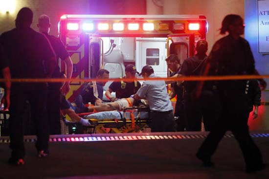 <div class='meta'><div class='origin-logo' data-origin='AP'></div><span class='caption-text' data-credit='AP Photo/Tony Gutierrez'>Emergency responders administer CPR to an unknown patient on a stretcher</span></div>