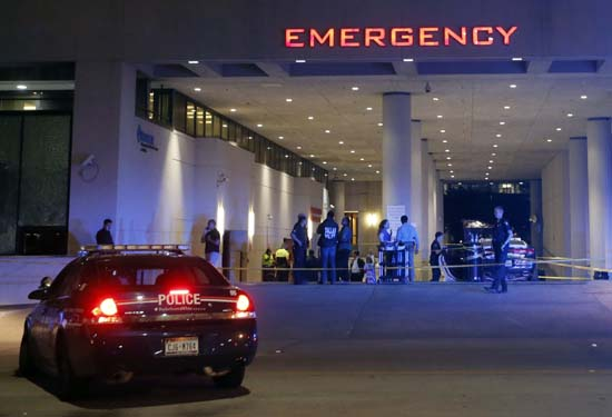 <div class='meta'><div class='origin-logo' data-origin='AP'></div><span class='caption-text' data-credit='AP Photo/Tony Gutierrez'>Law enforcement officers stand outside the emergency room at Baylor University Medical Center</span></div>