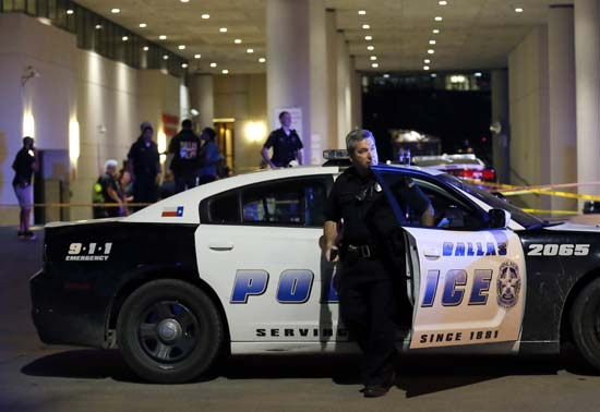 <div class='meta'><div class='origin-logo' data-origin='AP'></div><span class='caption-text' data-credit='AP Photo/Tony Gutierrez'>A Dallas police officer steps out of a vehicle as he arrives in front of Baylor University Medical Center</span></div>